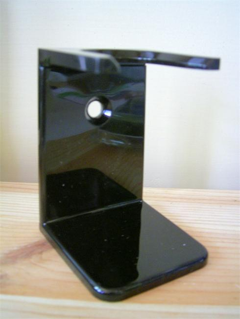 Shaving brush drip stand, in the colour black, it stand aprox 3