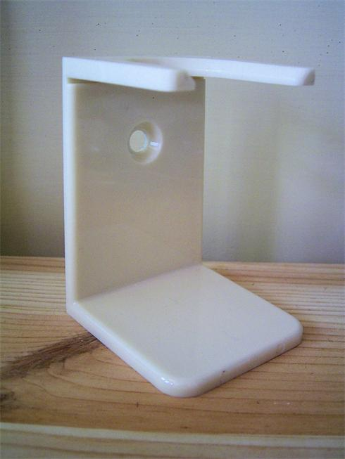 Quality shaving brush drip stand, in a cream colour, it stand aprox 3