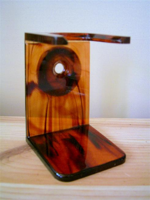 Quality shaving brush drip stand, in a tortoiseshell colour, it stands aprox 3