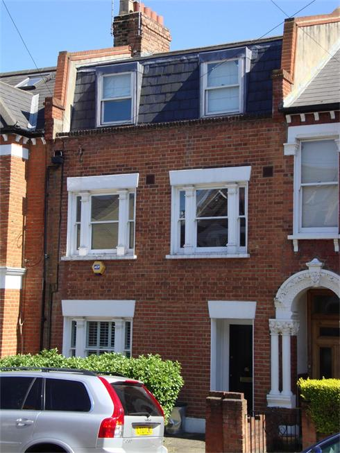 21. Loft conversion with  mansard roof extension and  alterations to house, SW11.