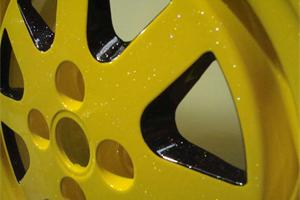 Custom powder coated yellow/black wheel with sparkle