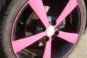 Custom powder coated wheel, Black Gloss with Pink front face finished in a sparkle lacquer