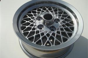 Old Jaguar wheel fully refurbished and powder coated in a chrome effect