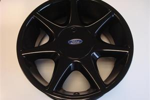 Ford wheel repaired and refurbished in black gloss finish, centre cap was removed and also resprayed