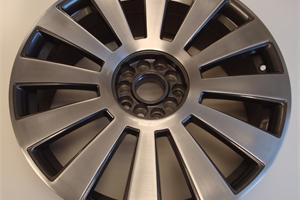 Audi wheel with a polished front face and lacquer. Diamond cut look, wheel was kerbed and corroded before completion.