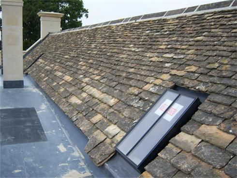 Velux Conservation Rooflight in  a stone tiled roof