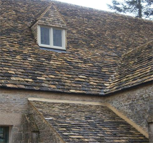 Stone tiled roof, swept valley and tiled dormer
