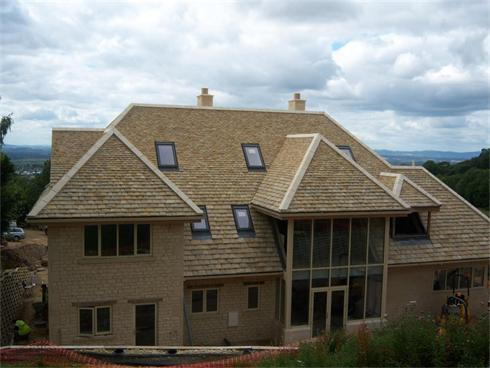 New House, roofed with new cotswold stone tiles, rear of house