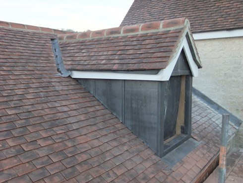 Lead Clad dormer in a new clay tiled roof