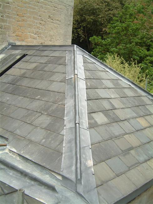 Small Welsh Slate roof with lead roll top ridge & Hips