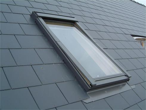 A Velux rooflight fitted in a cement/fibre slate roof