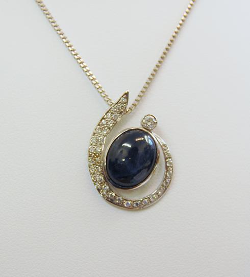 Star Sapphire pendant with pavé set diamonds.