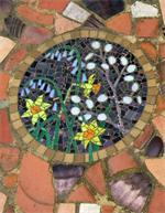 Mosaic set into recycled crocks on a doorstep.