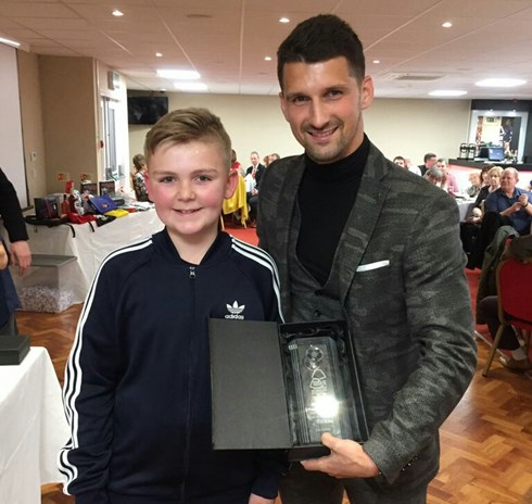 Newark branch member Joshua  Ridyard presents Eric Lichaj with  his branches 2016/17 Player of  the Season award.