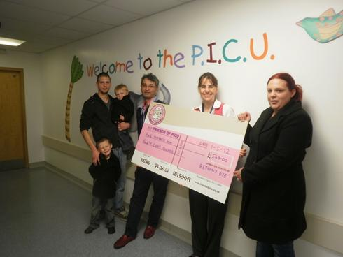 Bethany Dye presented Friends of PICU with a cheque after fundraising by doing a Fire Walk!