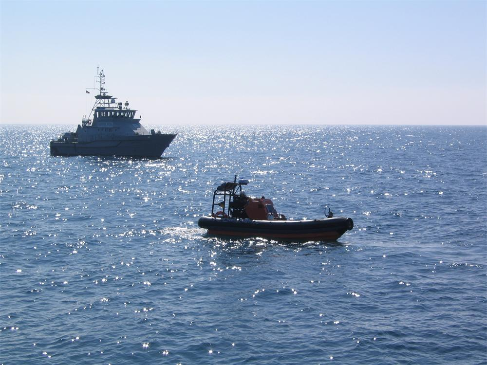 Fisheries patrol vessel Saint Piran at sea with RIB Lyonesse in foreground.