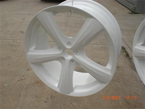Alloy wheel after blasting and primed ready for finish coat