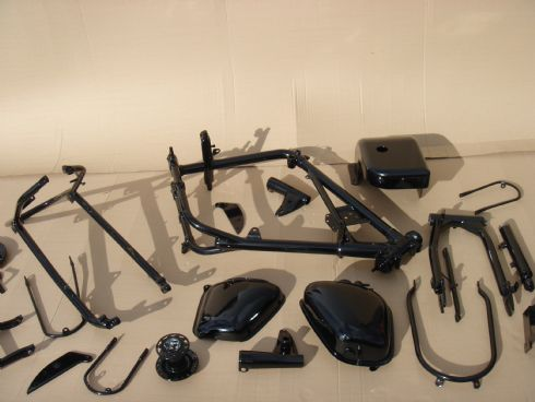 This is the motor bike and parts after being shot blasted zinc primed and top coated in black gloss