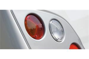 Indicator and Brake Light Surround, formed in a metalic silver - UV stable and durable!