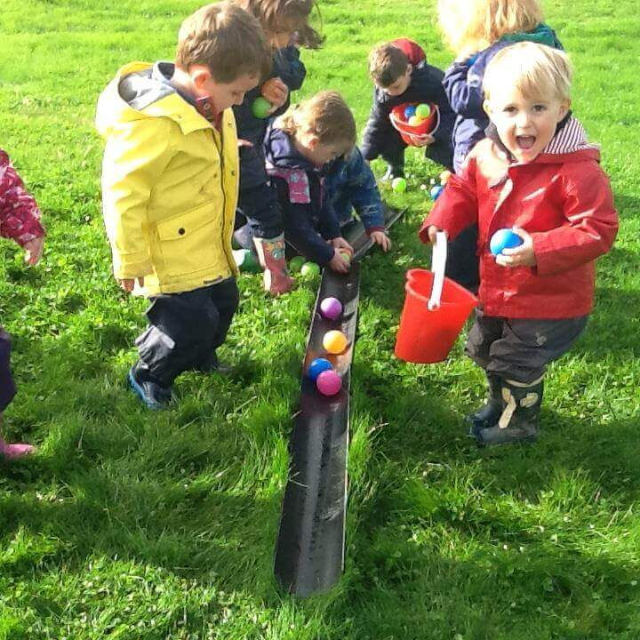 children playing and learning at nursery