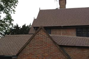 Clay roof tiles harmonising with victorian brickwork.
