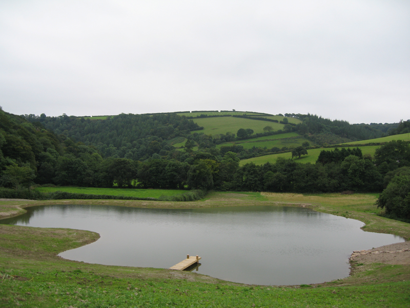 Three quarter acre lake with liner fitted and jetty