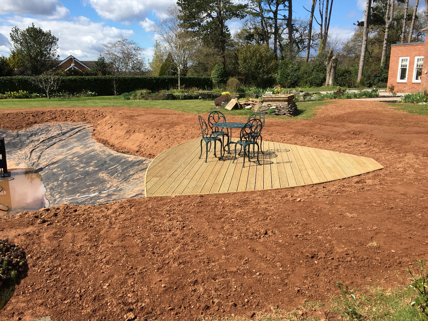 Large garden pond with sun lounger deck and liner installed in Somerset