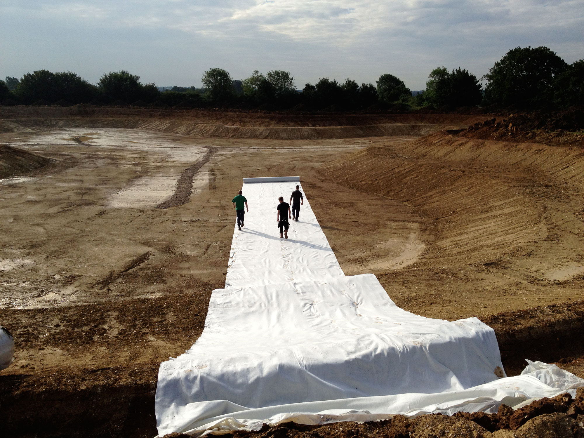 Underlay being installed in a lake
