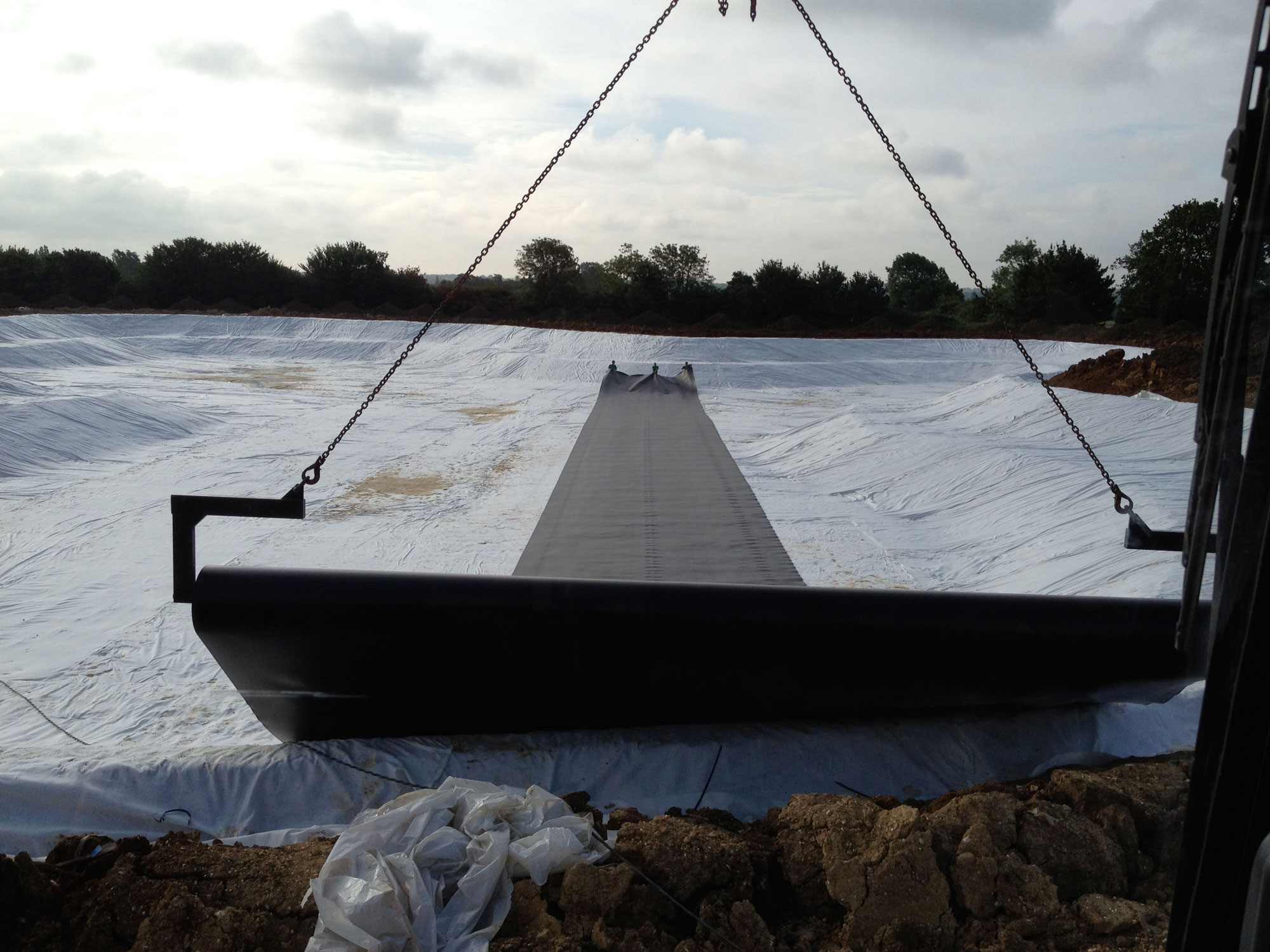 HDPE liner being rolled out over geomembrane on a Lake project in Essex