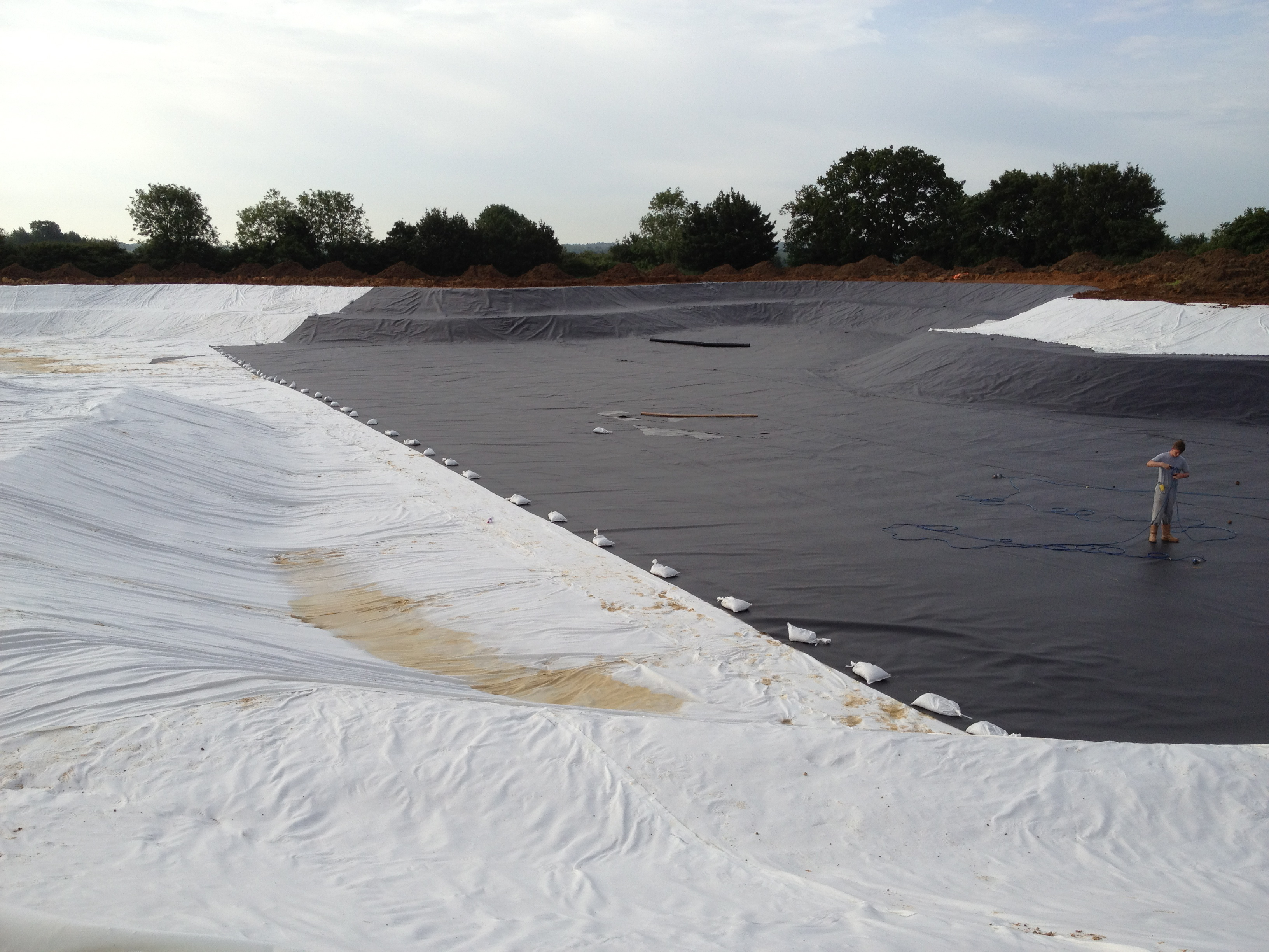 HDPE liner and geomembrane being installed for a Lake project in Cambridgeshire
