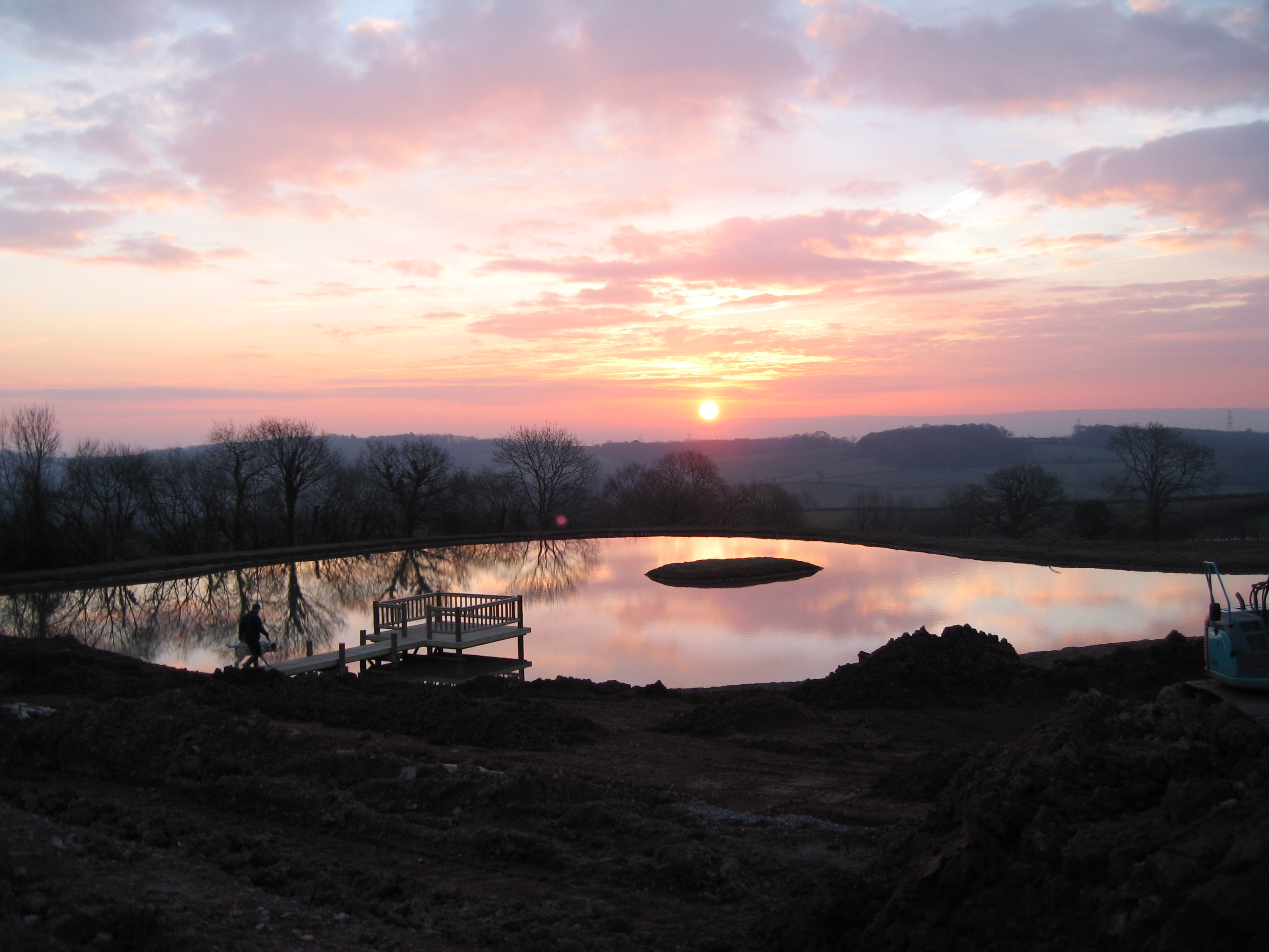 Sunrise over lake constructed in Bathelton Somerset