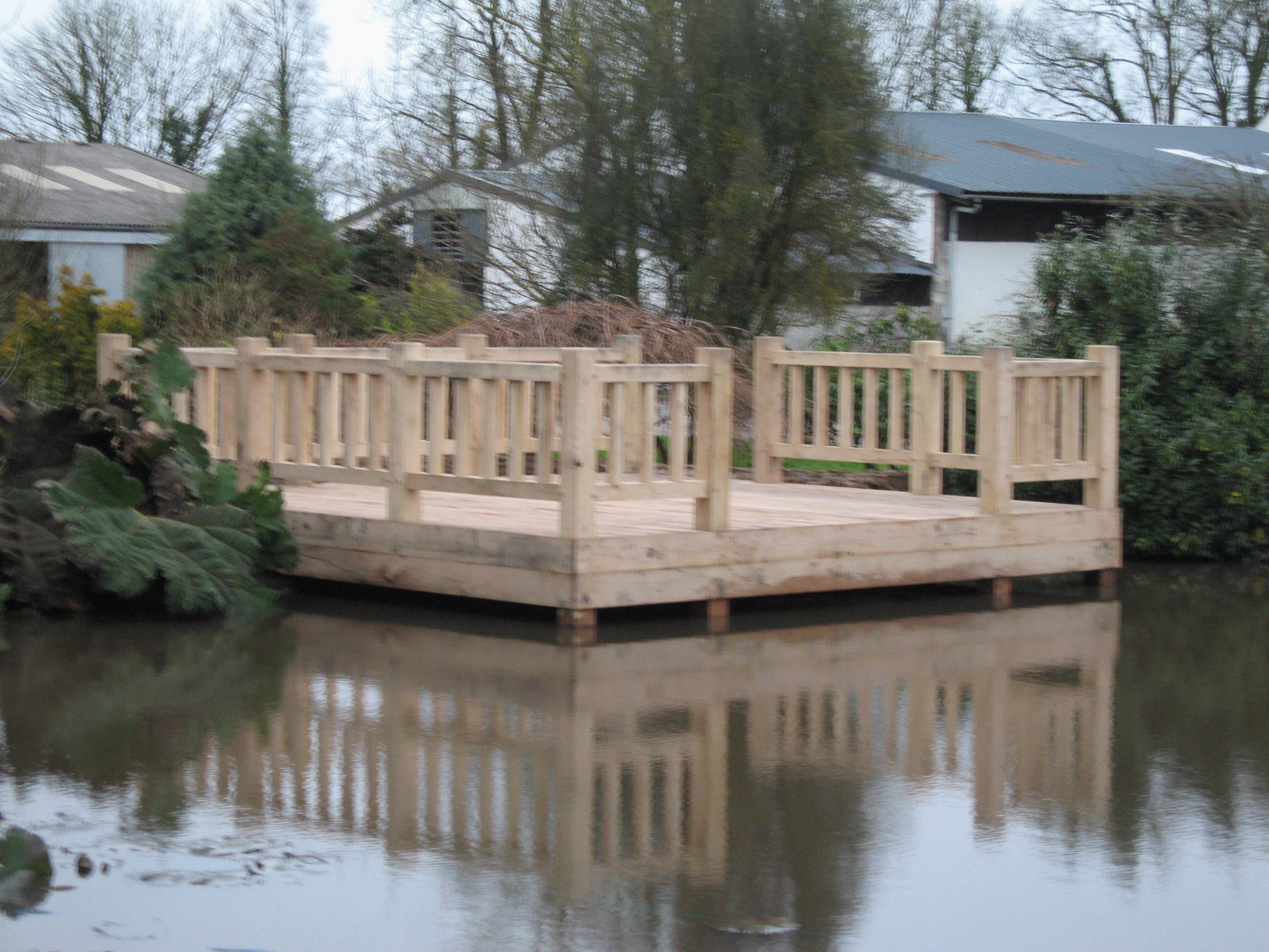 Large Oak cantilevered deck installed on a lake in Devon