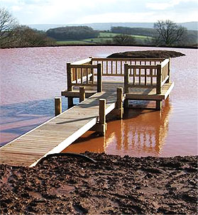 Large deck and jetty feature on a lake in Somerset
