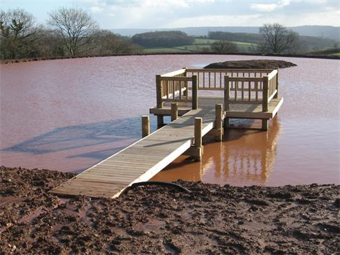 Large timber deck and jetty built on a Lake in Somerset