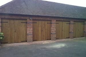 Four pairs of garage doors