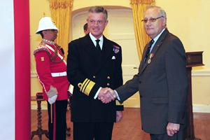 Capt James Ferro MBE receiving the Merchant Navy Medal from the Governor of Gibraltar
