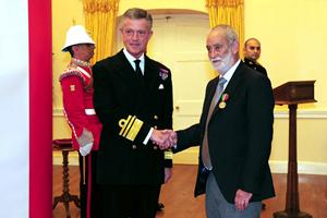 Douglas Pincho receiving the Merchant Navy Medal from the Governor of Gibraltar