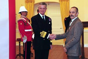 Ernest Lara receiving the Merchant Navy Medal from the Governor of Gibraltar