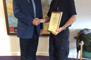Robert Walker receiving a Certficate of Commendation from Bob Jones, Chairman, MNWB upon his retirement from the Border Force and North & East Scotland PWC, Sept'14.