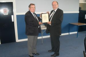 Peter White receiving a Certificate of Commendation from David Parsons, Chief Executive, MNWB upon his retirement as Chairman of the London & SE PWC, Sept'13