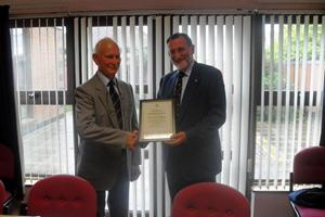 Terrance Wilson, MNA NI, receiving a Certificate of Commendation from Bob Jones, Chairman, MNWB on the occasion of his retirement from the Northern Ireland PWC, Sept'13