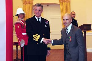Tommy Penalver receiving the Merchant Navy Medal from the Governor of Gibraltar