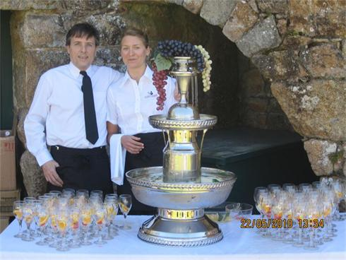 Staff serving the Pimms at St Ouens Manor