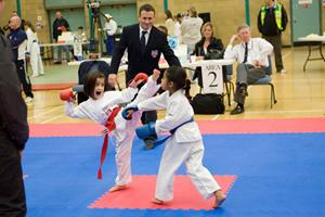 Antonia in action at a competition with high kicks