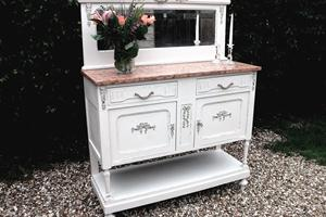 Antique mirrored chiffonier, painted and distressed with marble top and decorative detail.