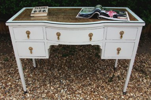 Antique desk, painted and distressed with leatherette glass top and antique gold drop handles.