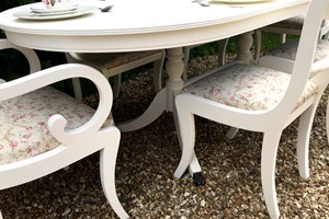 Shabby chic painted dining set with reupholstered seat covers.