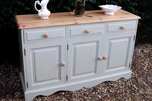 Farmhouse sideboard, painted and waxed with natural pine top and matching knobs.