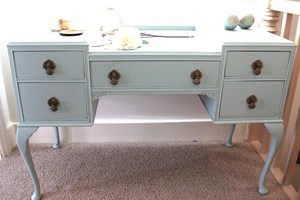 Louis style painted dressing table with painted gold drop handles.