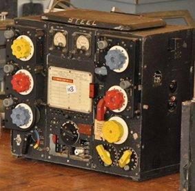 Vintage military radio sitting on a table